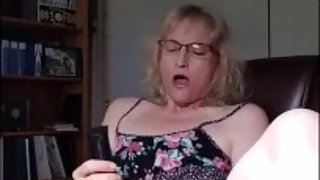 Hot milf with glasses masturbating till orgasm