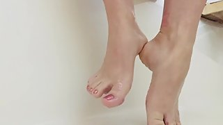 Slow motion oiled feet