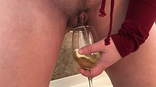 Sexy MILF pees her panties, fills a glass with piss and pours it on herself