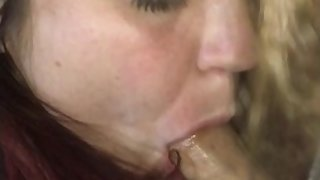 Wife taking great pleasure with a dick in her throat